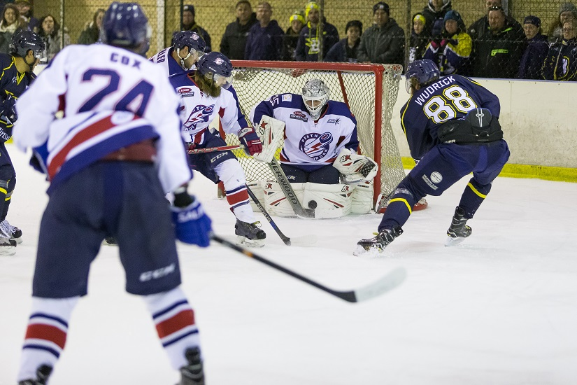 Perth Thunder goalie Peter Di Salvo shuts the door on CBR Brave forward Geordie Wudrick.
