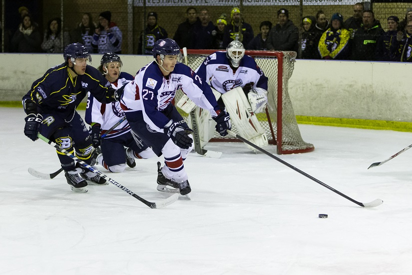 Perth Thunder captain Jamie Woodman exits the zone under pressure from CBR Brave forward Kai Miettinen